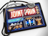 Joint Pain on the Display of Medical Tablet. — Stock Photo