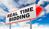 Real Time Bidding on Red Road Sign. — Stock Photo