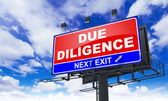 Due Diligence on Red Billboard. — Stock Photo