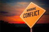 Conflict on Warning Road Sign. — Stock Photo