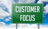 Customer Focus on Highway Signpost. — Stock Photo