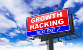Growth Hacking Inscription on Red Billboard. — Stock Photo