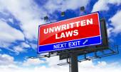 Unwritten Laws Inscription on Red Billboard. — Stock Photo