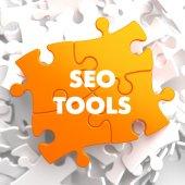 Seo Tools on Orange Puzzle. — Stock Photo