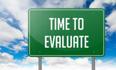 Time to Evaluate on Highway Signpost. — Stock Photo