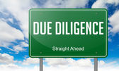 Due Diligence on Green Highway Signpost. — Stock Photo