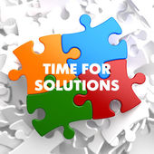 Time for Solutions on Multicolor Puzzle. — Stock Photo