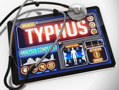 Typhus on the Display of Medical Tablet. — Stock Photo