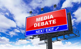 Media Debate on Red Billboard. — Stock Photo