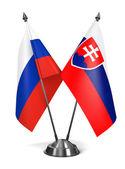 Russia and Slovakia - Miniature Flags. — Stock Photo