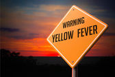 Yellow Fever on Warning Road Sign. — Stock Photo