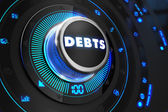 Debts Button with Glowing Blue Lights. — Stock Photo