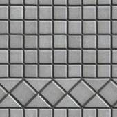 Grey Pave Slabs in the Form of Small Squares and Triangles. — Stock Photo
