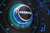 Credits Button with Glowing Blue Lights. — Stock Photo