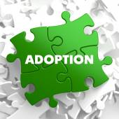 Adoption on Green Puzzle. — Stock Photo