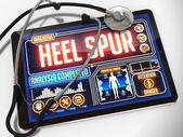 Heel Spur on the Display of Medical Tablet. — Stock Photo