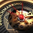 Benchmarking on Black-Golden Watch Face. — Stock Photo #69743391