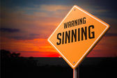 Sinning on Warning Road Sign. — Stock Photo