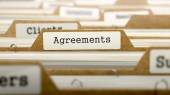 Agreements Concept with Word on Folder. — Stockfoto