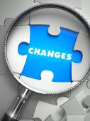 Changes - Puzzle with Missing Piece through Loupe. — Stock Photo