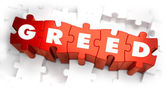 Greed - Text on Red Puzzles. — Stock Photo