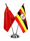 China and Uganda - Miniature Flags. — Stock Photo