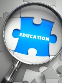 Education - Puzzle with Missing Piece through Loupe. — Stock Photo