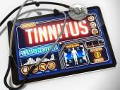 Tinnitus on the Display of Medical Tablet. — Stock Photo