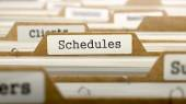 Schedules Concept with Word on Folder. — Stock Photo