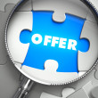Offer - Missing Puzzle Piece through Magnifier. — Stock Photo #74716139