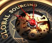 Global Sourcing on Black-Golden Watch Face. — Stock Photo