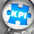 KPI - Missing Puzzle Piece through Magnifier. — Stock Photo #76343075