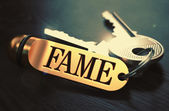 Fame written on Golden Keyring. — Stock Photo