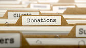 Donations Concept with Word on Folder. — ストック写真