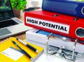 High Potential on Red Ring Binder. Blurred, Toned Image. — Stock Photo