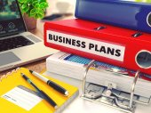 Business Plans on Red Office Folder. Toned Image. — Stock Photo