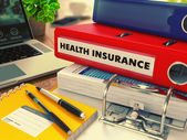 Red Office Folder with Inscription Health Insurance. — Stock Photo