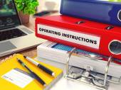Operating Instructions on Red Office Folder. Toned Image. — Stock Photo
