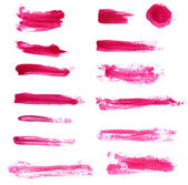 Collection of red cosmetic lipstick and nail polish isolated swatches. — Stock Photo