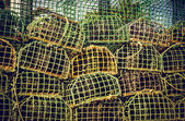 Pile group of fishing cage traps — Stock Photo