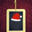Hanged Slate with Christmas cap — Stock Photo #59123333