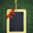 Hanged Slate with Christmas bow — Stock Photo #59123341