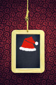 Hanged Slate with Christmas cap — Stock Photo