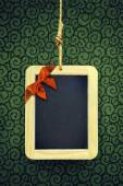 Hanged Slate with Christmas bow — Stock Photo