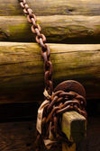 Wooden trunks secured with chain — Stock Photo