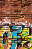 Brickwall with colorful graffiti — Stock Photo