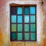 Grunge window with rusty iron bars — Stock Photo #70407919