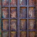 Grunge window with rusty iron bars — Stock Photo #70407933