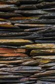 House with piled schist stone blades — Stock Photo