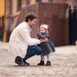 Father takes his little daughter in his arms — Stock Photo #60591937